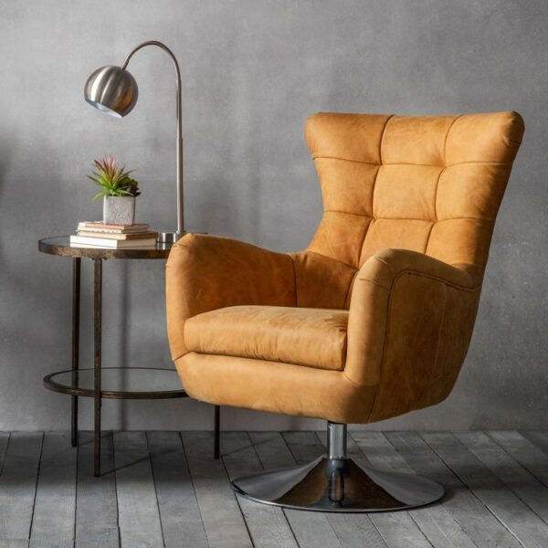 leather chair with side lamp and table